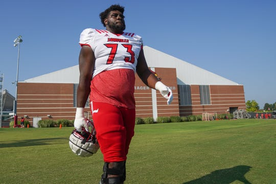 Louisville offensive lineman Mekhi Becton (73) walks onto the field before practice in Louisville, Ky., Wednesday, August 14, 2019.