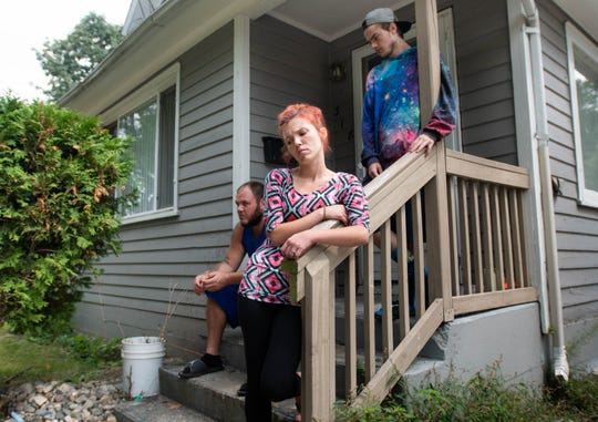 Nikki Heddens, 28, middle, is a foster parent to her two nieces.  She says the home she rents on Carey Street is rat infested, and she can't afford to move.  Also pictured Aug. 20, 2019, is her boyfriend Mark Jones, left, and her brother Ryan Heddens, 18.