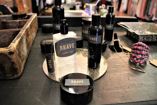 Brave Woman Boutique offers its own brand of perfume, body butter, lotion, and candles called Brave. Owner Erica Jury said the fragrance is a combination of cigar, leather, teak wood, and apricot.