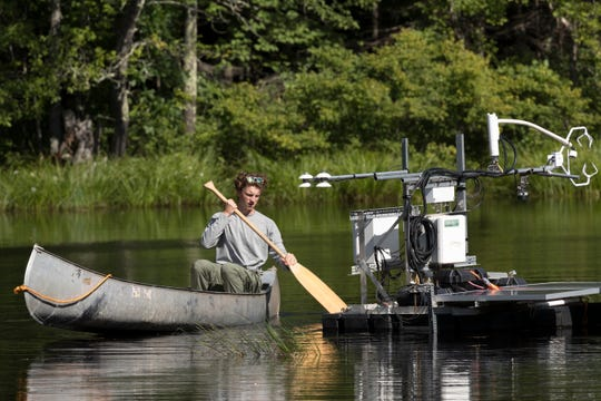 James Mineau, a sophomore at UW-Madison, paddles out to one of 19 flux towers collecting environmental data Aug. 21 in the Chequamegon-Nicolet National Forest outside Park Falls, Wis., as part of a project dubbed CHEESEHEAD19.