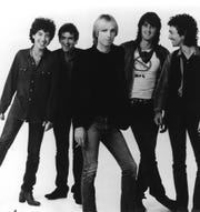 """Milwaukee native Howie Epstein, left, pictured here with Tom Petty and the Heartbreakers in a 1983 press photo, played bass for the band for 20 years. Epstein, who died in 2003, is celebrated on a new album of '70s demos, """"The Music of Howie Epstein Vol. 2,"""" released by his brother Craig."""