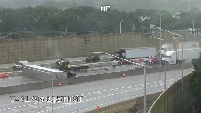 An overturned semi is causing traffic trouble on a busy Milwaukee area freeway.