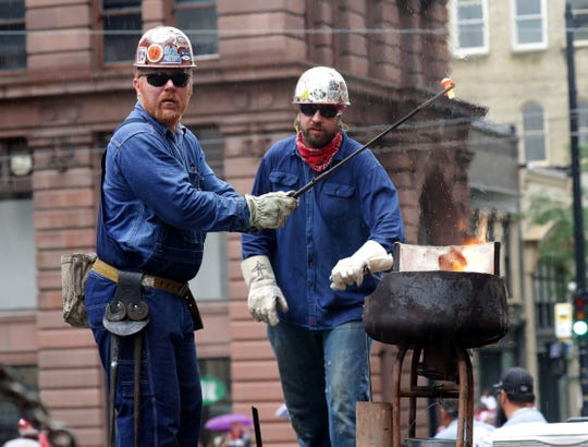 Jason Kallin, left, and Rich Kangas of Iron Workers Local 8 show how it's done at last year's Labor Day parade. This year's parade, kicking off Laborfest, starts at 11 a.m. Monday.