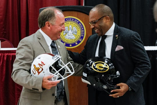 ULM head coach Matt Viator (left) and Grambling head coach Broderick Fobbs (right) share a moment following a press conference at the Monroe Civic Center. Fobbs was an assistant to Viator for seven seasons at McNeese State.