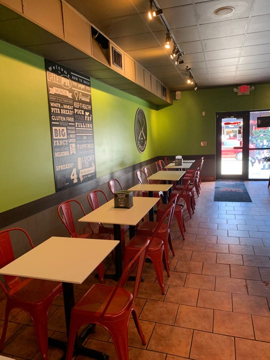For its grand opening, the Pita Pit  located at The Village has a new look, complete with new paint, tables and chairs, wall murals, hanging lights, a grill and digital TV menu boards.
