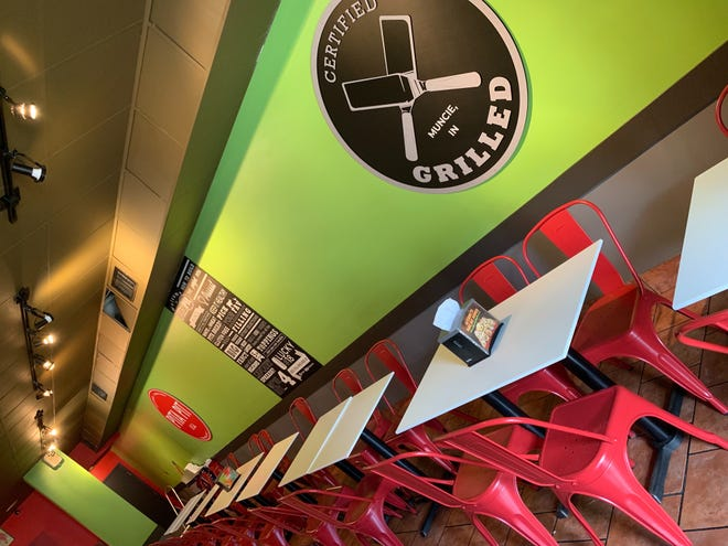 For its grand re-opening, the Pita Pit  located at The Village has a new look, complete with new paint, tables and chairs, wall murals, hanging lights, a grill and digital TV menu boards.