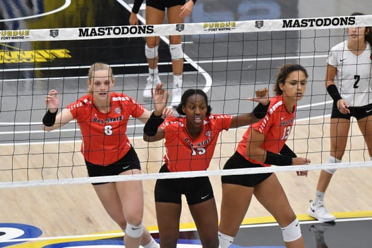 Ball State freshmen Allison Hamaker, MyKel Ivy and Natalie Mitchem compete during the Cardinals' scrimmage against Purdue Fort Wayne. They are three of nine true freshmen on the team.