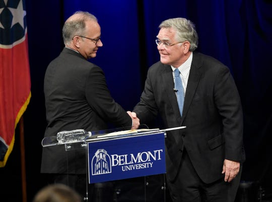 Nashville Mayor David Briley and At-Large Metro Councilman John Cooper shake hands at the start of the mayoral debate at Belmont University's Troutt Theater in Nashville, Tenn., Monday, Aug. 26, 2019.