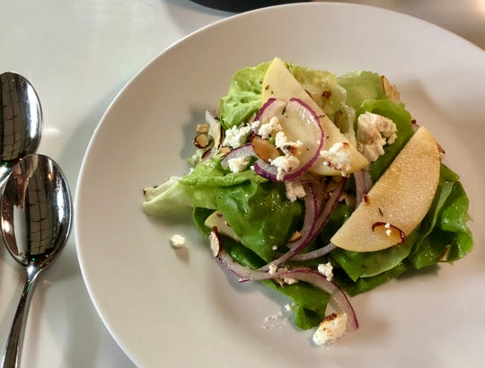 Bibb Salad w/ apple, red onion, toasted goat cheese, almonds, garlic-thyme vinaigrette at Santo in Green Hills.