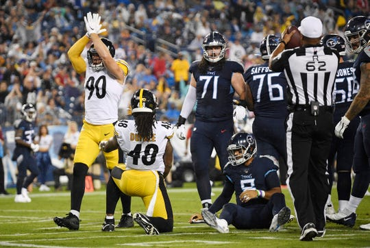 Steelers outside linebacker T.J. Watt (90) celebrates a sack of Titans quarterback Marcus Mariota (8) in the end zone during the first quarter of Sunday's preseason game.