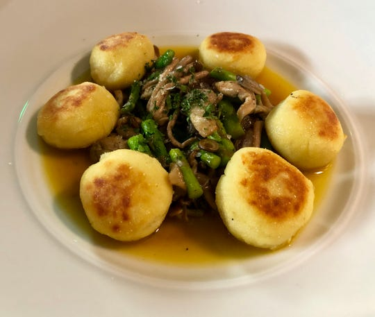 Ricotta Gnudi in saffron broth with mushrooms, caramelized onions and asparagus at Santo in Green Hills.