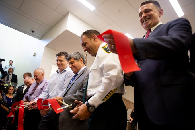 Elected officials from Lee County and Bonita Springs participate in a ribbon-cutting ceremony for the new public library in Bonita Springs on Monday, August 26, 2019.
