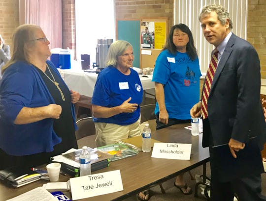 U.S. Sen. Sherrod Brown talks to (from left) Tresa Tate Jewell, Linda Mossholder and Patricia Perry about poverty and homelessness Monday at a campaign fundraiser for Democratic mayoral candidate Jeremy Blake.