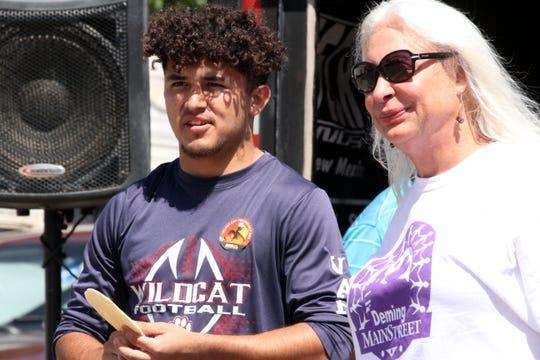 Deming MainStreet Executive Director Christie Ann Harvey and Tortilla Toss winner Jesse Varela share a moment.