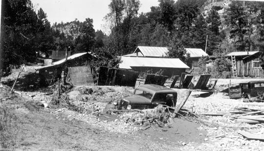 A flood on the Rio Ruidoso in 1941 destroyed cabins and automobiles.