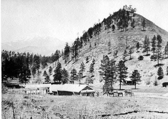 The Old Dowlin Mill was one of the few buildings in the Ruidoso area before 1900. Note the horses at right and the water flume that fueled the grist mill at left. The adobe structure burned a few years ago, but may be restored.