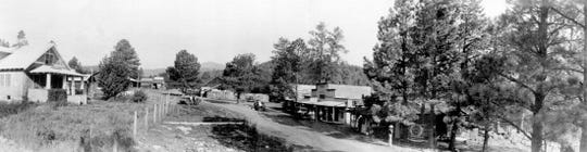 The home of Ike Wingfield is at left, one of the few structures near the entrance to what is now called Upper Canyon in Ruidoso. The street is Sudderth Drive.