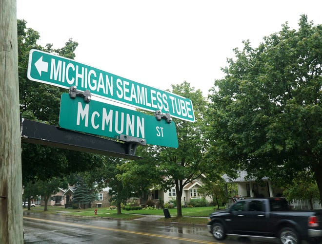 Michigan Seamless Tube sign attached to South Lyon's McMunn Street sign.