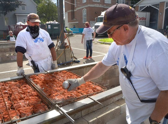 Chicken is prepared by volunteers during a recent Fall Festival.