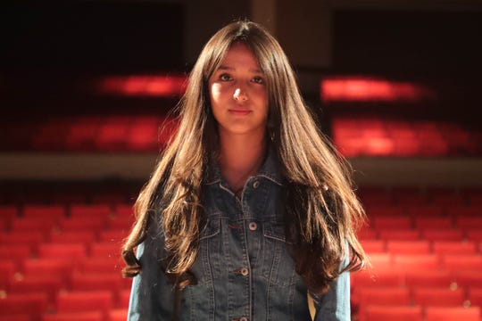 Isabella Madrigal stands on stage during rehearsal for Menil and Her Heart: A Cahuilla Play, at Sherman Indian High School in Riverside, Calif. on Friday, August 23, 2019.