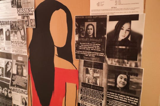 Signs hang for missing indigenous women during rehearsal for Menil and Her Heart: A Cahuilla Play at Sherman Indian High School in Riverside, Calif. on Friday, August 23, 2019.