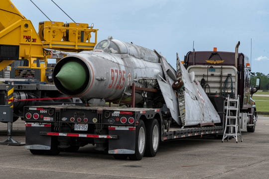Workers unload components for a MiG-21 at the National Naval Aviation Museum on board Naval Air Station Pensacola on Monday, Aug. 26, 2019.