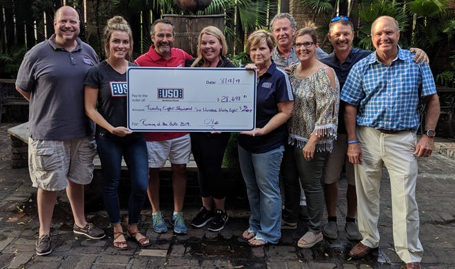 """In its ninth year, the annual """"Running of the Bulls"""" race raised $28,698to benefit the USO of Northwest Florida."""