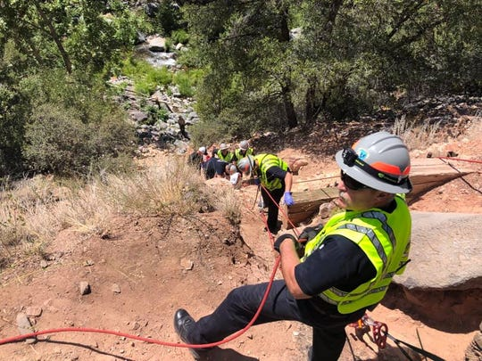Sedona Fire Department works to rescue an 8-year-old girl who fell 75 feet on Sunday afternoon.