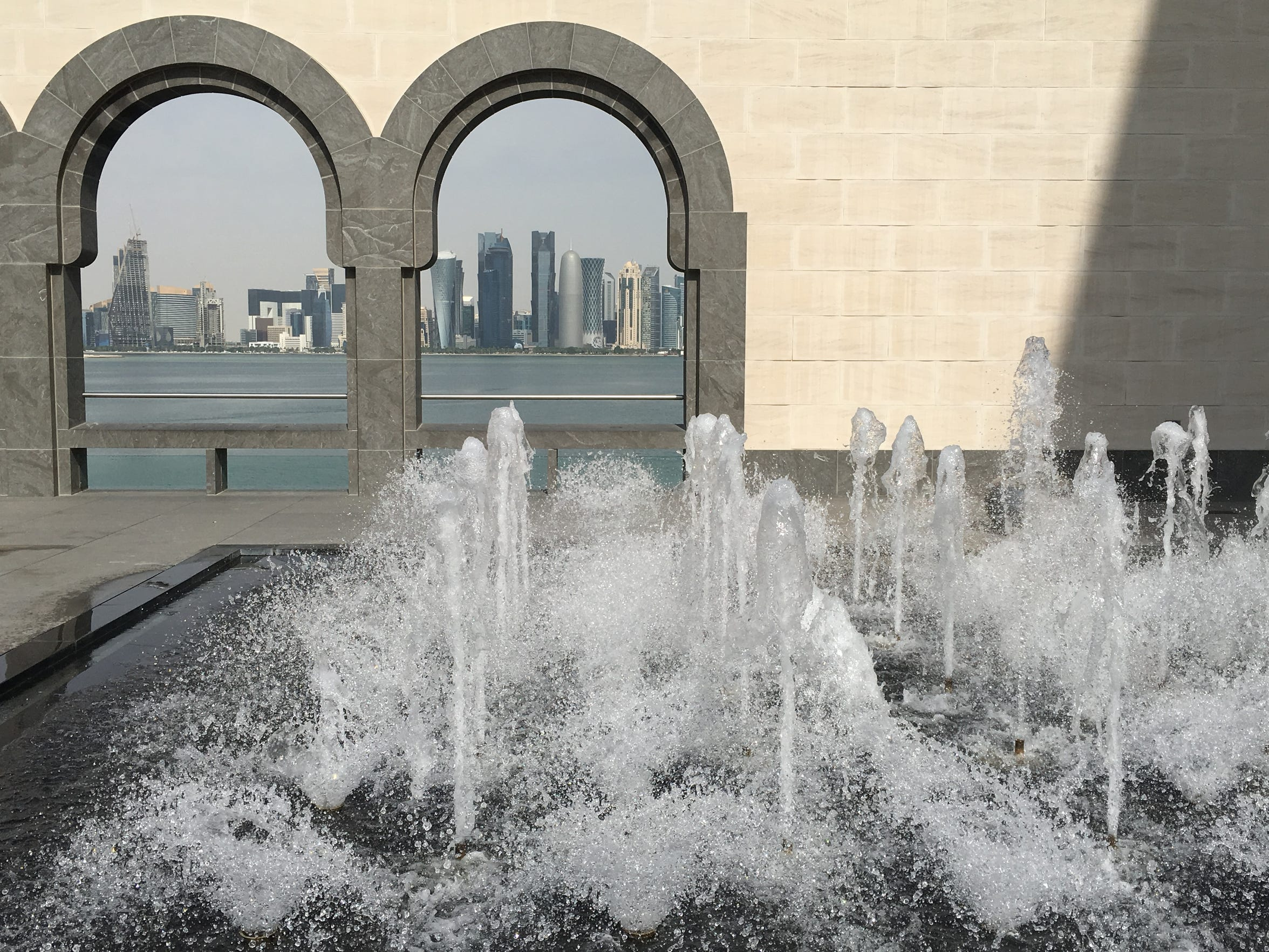 A fountain flows at the Museum of Islamic Art in Doha, Qatar, with the city skyline in the background. Doha has grown rapidly during the past two decades and relies on desalinated water.