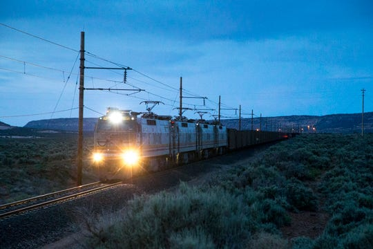 The Black Mesa and Lake Powell Railroad electrified train (BLKM) starts it's 78-mile trip from the Kayenta Mine load-out silos, May 30, 2017, to the Navajo Generating Station. The train had 83 cars, each carrying 100 tons of coal.