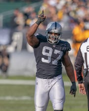 Oakland Raiders defensive tackle Clinton McDonald (97) celebrates after sacking Pittsburgh Steelers quarterback Ben Roethlisberger (not pictured) during the second quarter at Oakland Coliseum.