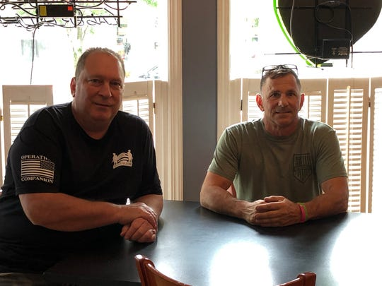 John Saad (left) and Romeo Lamarco, two of the four owners of the Dauphin County-based Ted's Bar & Grill restaurant chain, have a seat in the new Annville location.