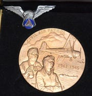 Dottie Patrick was awarded the Civil Air Patrol's Congressional Gold Medal by then-governor John Kasich for her service in the CAP's Ohio Wing during World War II.