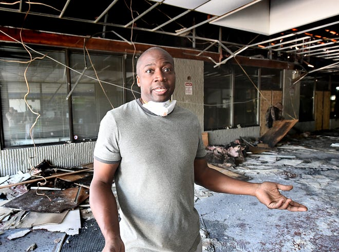 Halman Smith II, who owns Comfort Zone Mattress with his wife Montika, talks about his business in a common area in the fire-damaged Yorktown Mall Monday, Aug. 26, 2019. Fire damaged several businesses there after a fire occurred early Friday, Aug. 23. Bill Kalina photo