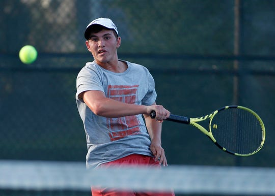 Peter Landis returns the ball to Phil Myers during the York City-County men's singles tennis title match, Monday, August 26, 2019.John A. Pavoncello photo
