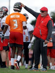 Tampa Bay Buccaneers head coach Bruce Arians pats quarterback Jameis Winston (3) on the helmet during an NFL football training camp practice Saturday, July 27, 2019, in Tampa, Fla. (AP Photo/Chris O'Meara)