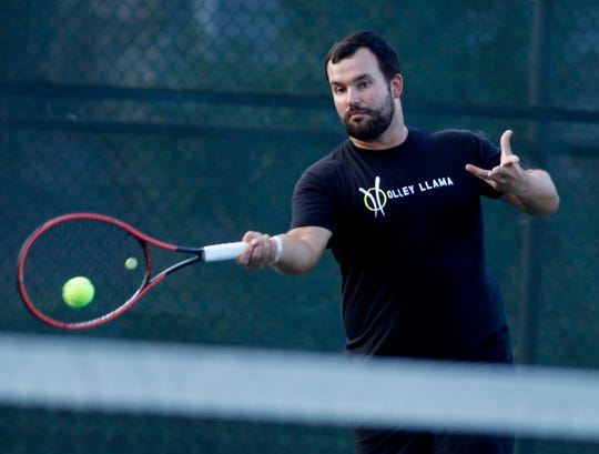 Phil Myers returns the ball to Peter Landis during the York City-County men's singles tennis title match, Monday, August 26, 2019.