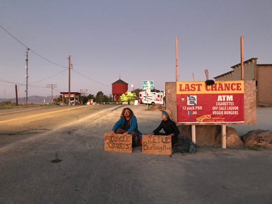 A pair of Burners beg for tickets in Gerlach early Monday, Aug. 26.
