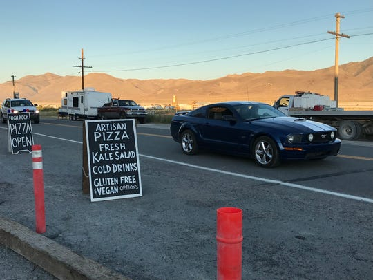 Vehicles drive through the town of Gerlach on their way to Burning Man on Sunday, Aug. 25.