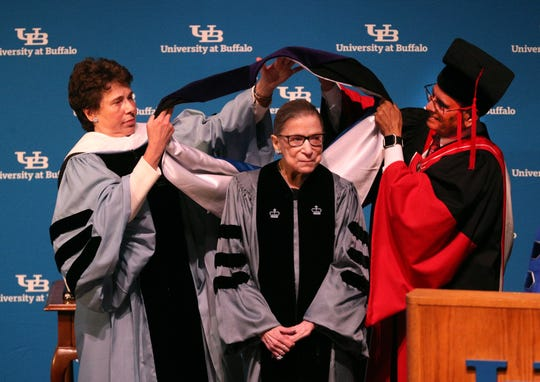 Justice Ruth Bader Ginsburg takes part in the hooding ceremony as she is awarded a Honorary Degree at the University of Buffalo. UB president, Satish K. Tripathi (right) and acting Chairman of SUNY Board of Trustees  Merryl H. Tisch also pictured.