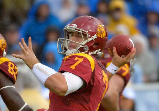 Matt Barkley led USC against Andrew Luck and Stanford three times, and Barkley's Trojans lost all three games.
