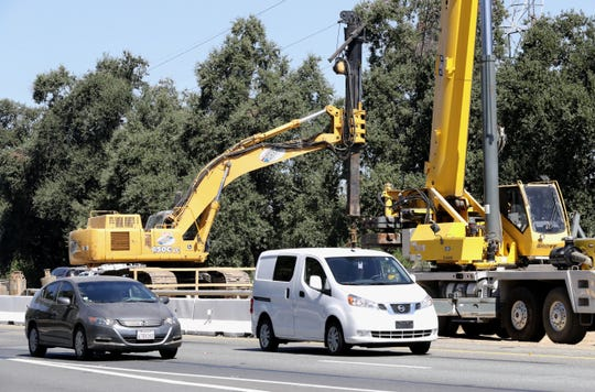 Cars drive beside the Redding to Anderson Six Lane Expansion Project on Interstate 5 on Monday, Aug. 26, 2019, where the speed limit is 55 mph.