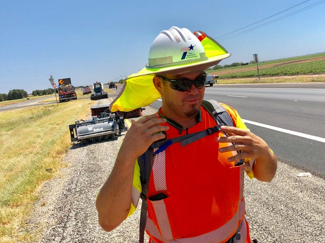 San Angelo Maintenance crew chief Steve prepares to push through the Texas heat on US 87 east of Wall on Monday, Aug. 26.