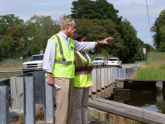 Sen. Tom Carper (D-Delaware) talks to Delaware Department of Transportation's chief engineer Shanté Hastings about flooding issues on New Road in Lewes, on Monday, Aug. 26.