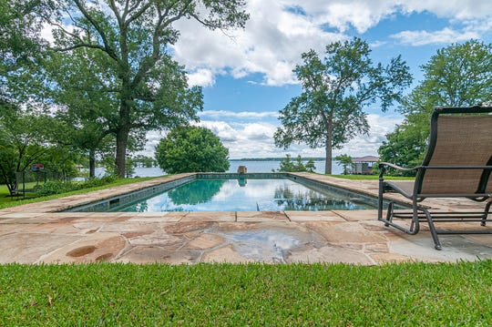 Enjoy swimming in the saltwater pool while overlooking the lake.