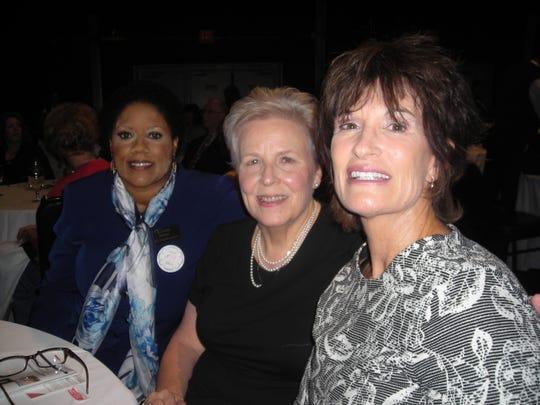 YWCA Chief Belinda Robinson, Simone Henessee, Retired Drug Enforcement Special Agent Pamela Brown at YWCA Luncheon.