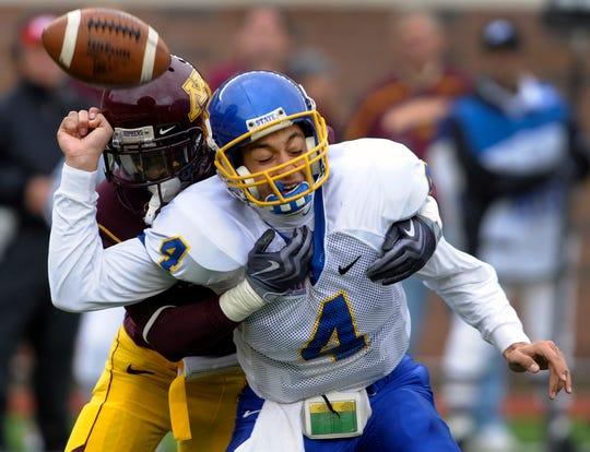 Minnesota's Michael Green, left, sacks South Dakota State quarterback Thomas O'Brien (4) causing O'Brien to fumble the ball during the second quarter of an NCAA college football game Saturday, Nov. 14, 2009, in Minneapolis.