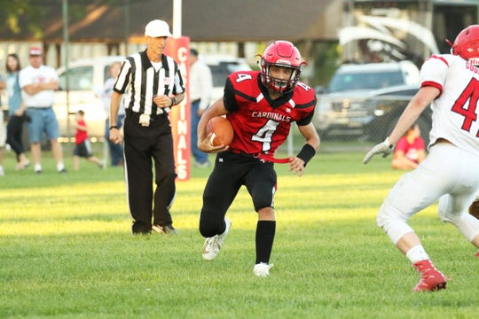 Connor Libis of Dell Rapids St Mary looks for an opening as Jake Goodfellow of Estelline-Hendricks pursues on Friday, Aug. 23, 2019 in Dell Rapids.