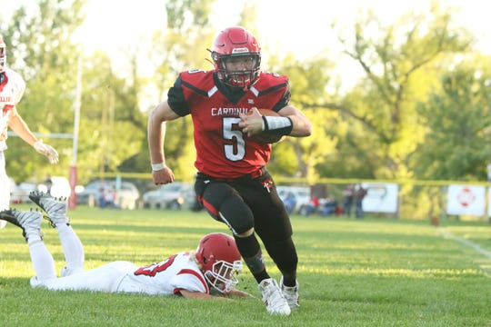 Eli Longville of Dell Rapids St Mary sprints past Davon Dahl of Estelline-Hendricks for a touchdown on Friday, Aug. 23, 2019 in Dell Rapids.