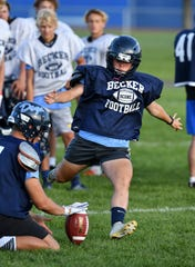 Emma Domka winds up to kick a field goal during practice Wednesday, Aug. 21, 2019, at Becker High School.